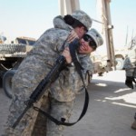 CAMP VIRGINIA, KUWAIT - DECEMBER 18: Specialist Ashley Walter (R) hugs specialist Angelica Reyes from the 3rd Brigade, 1st Cavalry Division after Reyes arrived in the last American military convoy to depart Iraq on December 18, 2011.